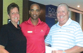 Gulf Weekly Hill couple tee-off in style